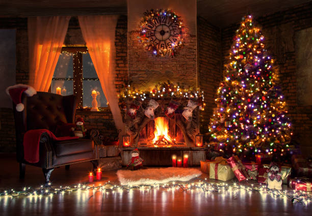 Beautiful living room with fire place decorated for christmas stock photo