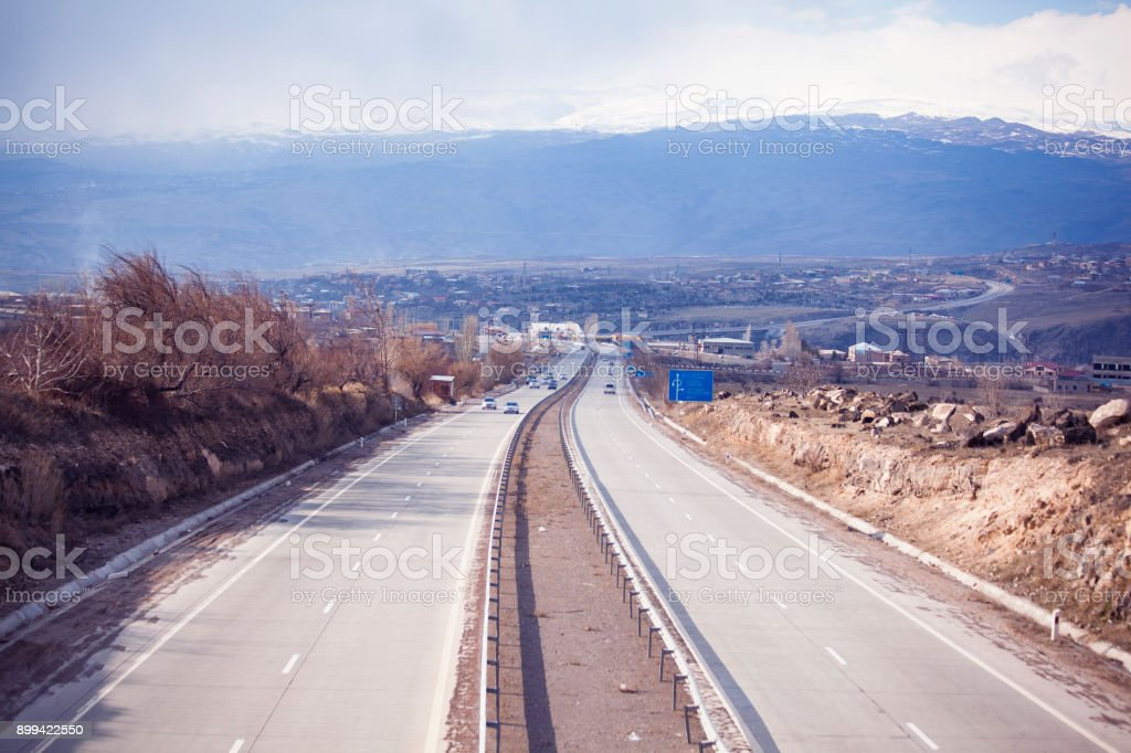 beautiful long asphalt road stock photo