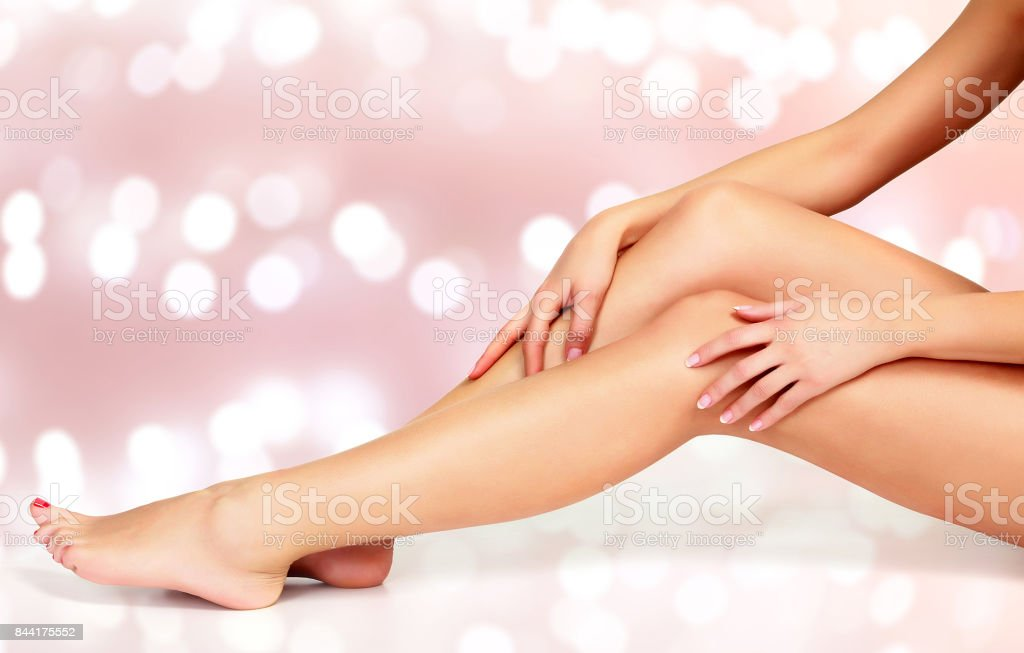 Beautiful long woman's legs and hands stock photo