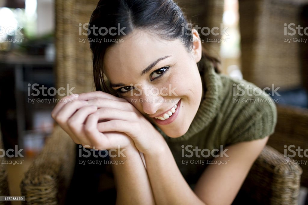 Beautiful Lovable Young Woman Portrait, Smiling at Camera, Hands Clasped royalty-free stock photo
