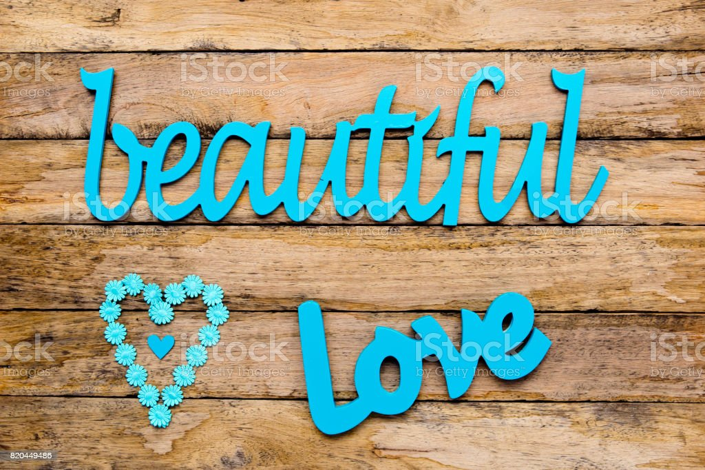 Beautiful Love Blue Turquoise Wooden Words With Heart Shape On