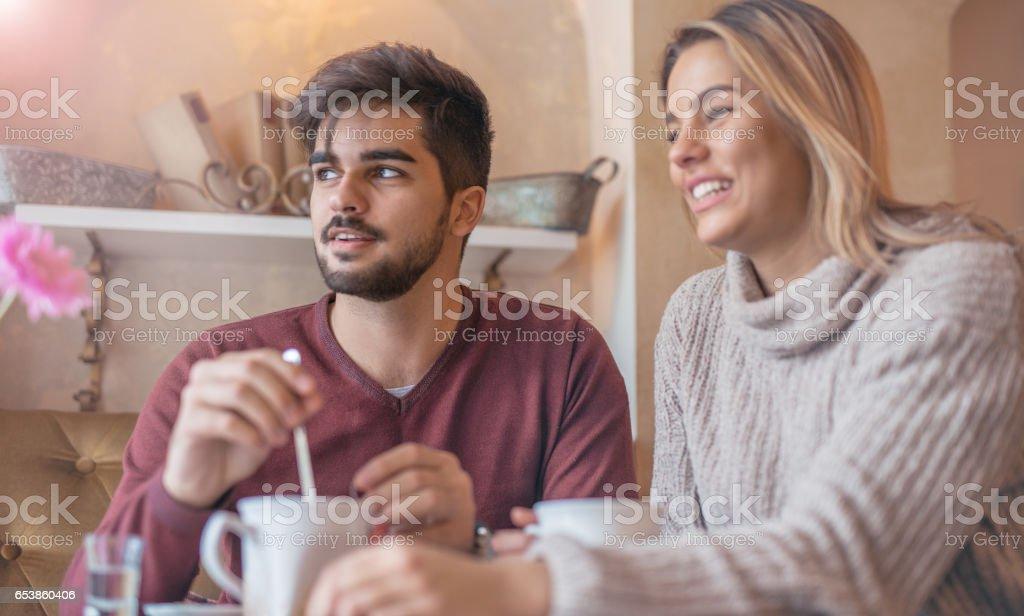 Beautiful Loving Couple Flirting In A Cafe Enjoying In