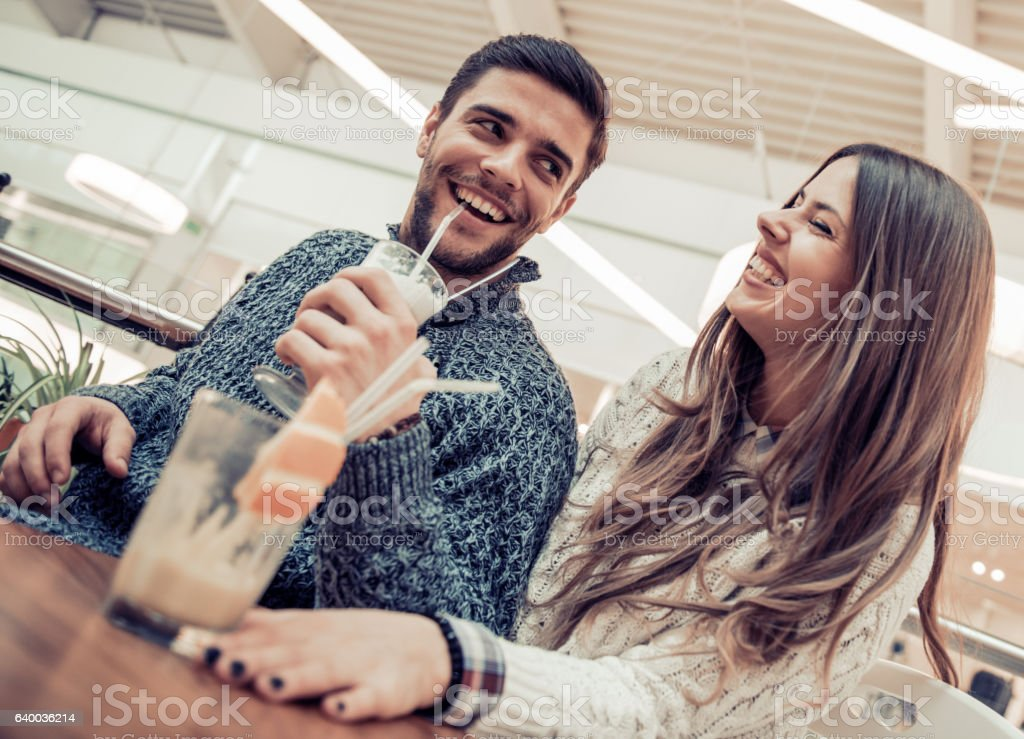 Beautiful loving couple flirting in a cafe stock photo
