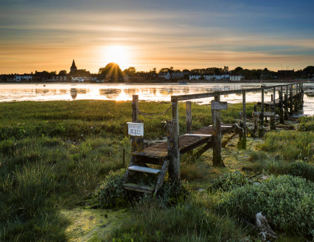 Beautiful Low tide landscape of Bosham Harbour with private jetty. stock photo