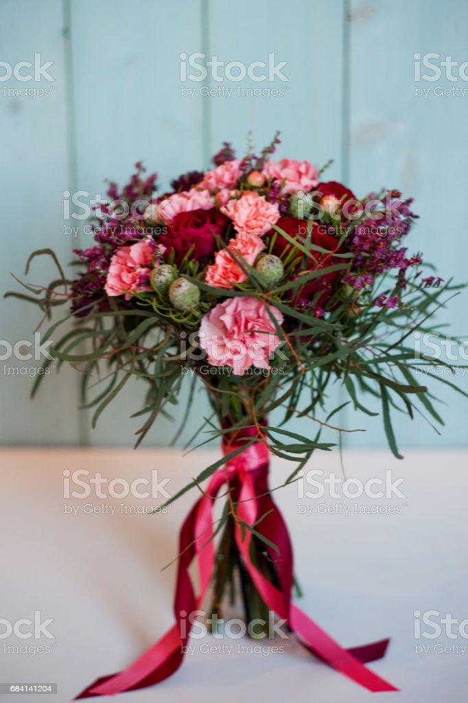 beautiful lush bouquet with roses, turquoise background, gift royaltyfri bildbanksbilder