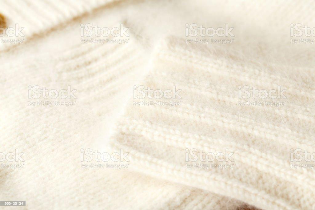 Beautiful, luxurious, knitted cardigan in white, autumn, winter, warm. zbiór zdjęć royalty-free