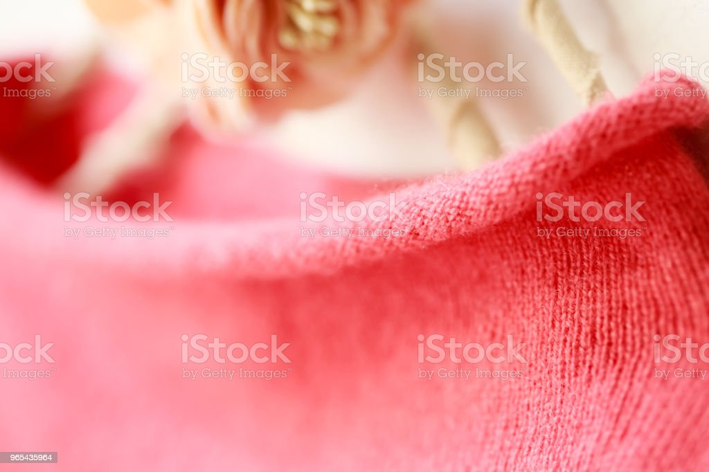 Beautiful, luxurious, knitted high neck sweater in pink, autumn, winter, warm. royalty-free stock photo
