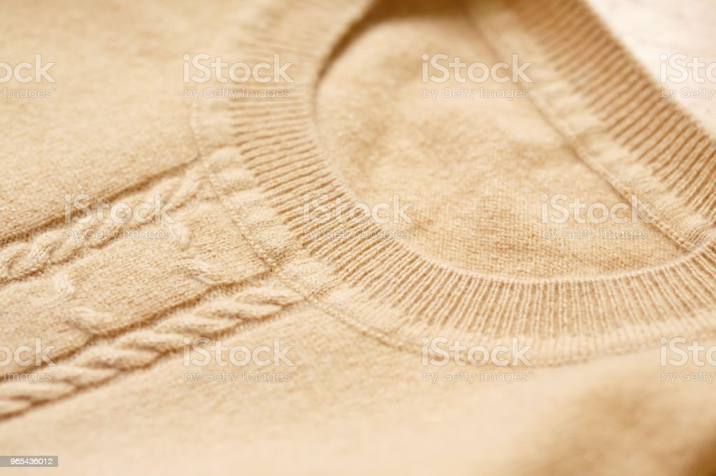 Beautiful, luxurious, knitted sweater in beige, autumn, winter, warm. royalty-free stock photo