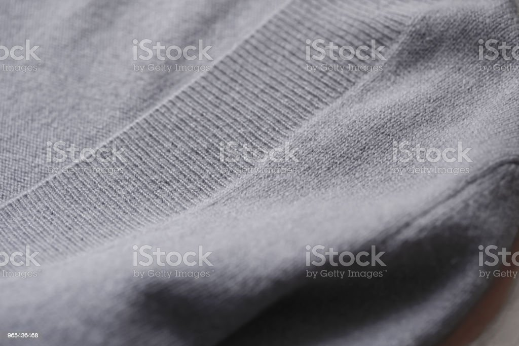 Beautiful, luxurious, knitted sweater in grey, autumn, winter, warm. zbiór zdjęć royalty-free