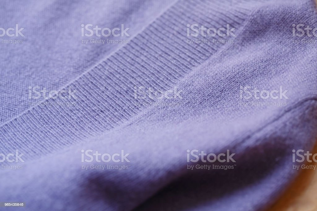 Beautiful, luxurious, knitted sweater in purple, autumn, winter, warm. royalty-free stock photo