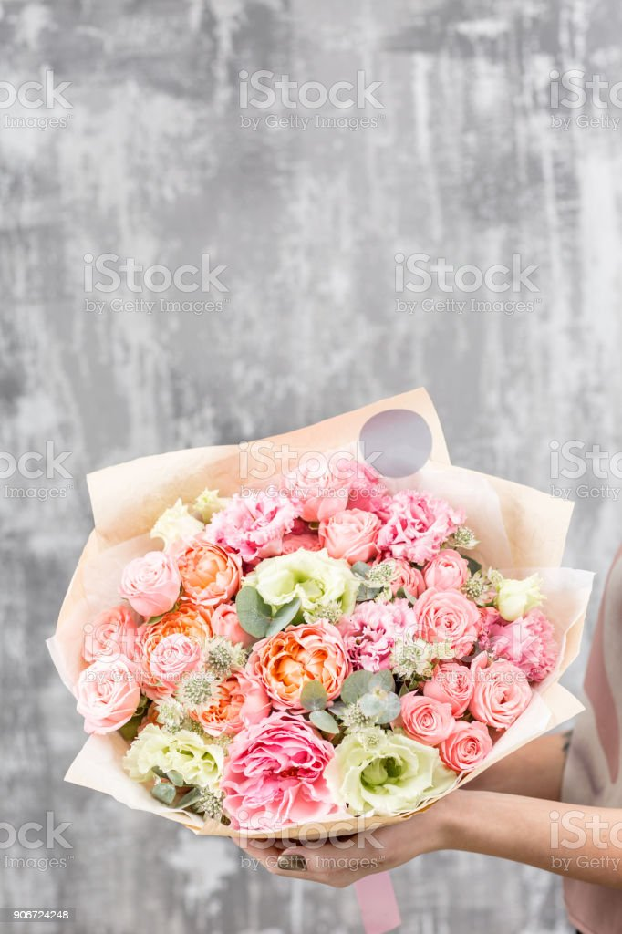 beautiful luxury bouquet of mixed flowers in woman hand. the work of...