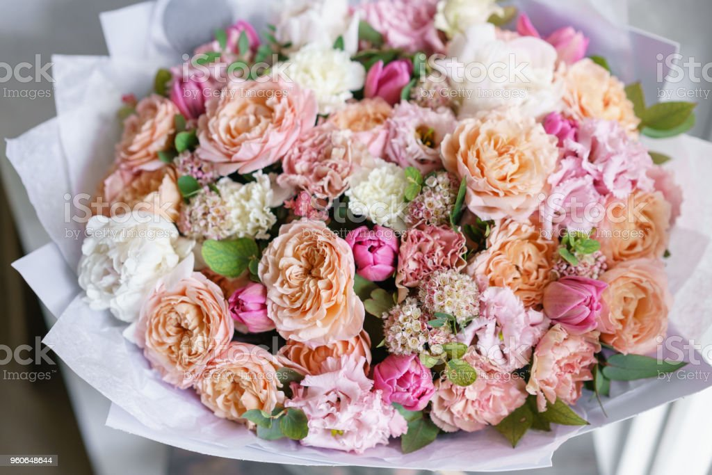 Spring mood. beautiful luxury bouquet of mixed flowers in woman hand....