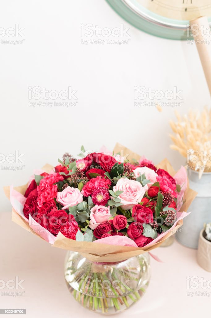 Beautiful Luxury Bouquet Of Mixed Red And Pink Flowers In Glass