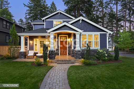 istock Beautiful luxury home exterior at twilight 1026205392