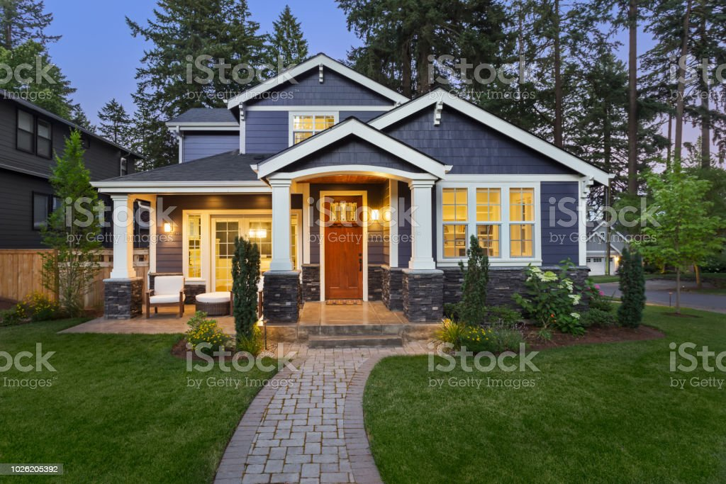 Beautiful luxury home exterior at twilight stock photo