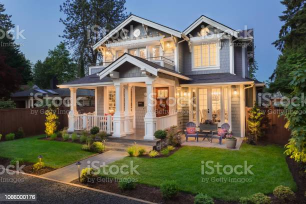 Photo of Beautiful luxury home exterior at twilight