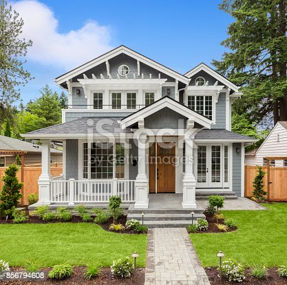 istock Beautiful Luxury Home Exterior with Green Grass and Landscaped yard 856794608