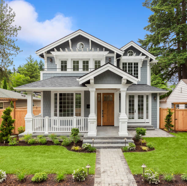 Beautiful Luxury Home Exterior with Green Grass and Landscaped yard stock photo