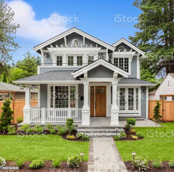 new luxury home with elegant touches including covered entrance, columns