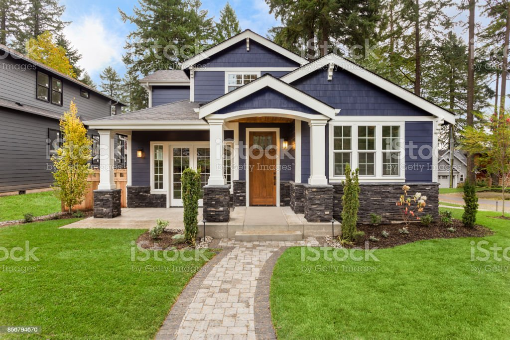 Beautiful Luxury Home Exterior With Green Grass And Landscaped Yard ...