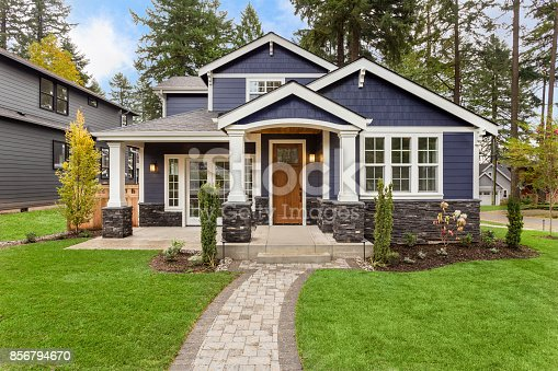 istock Beautiful Luxury Home Exterior with Green Grass and Landscaped yard 856794670