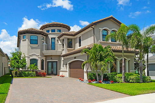 Outdoor front of a magnificent large luxury home.