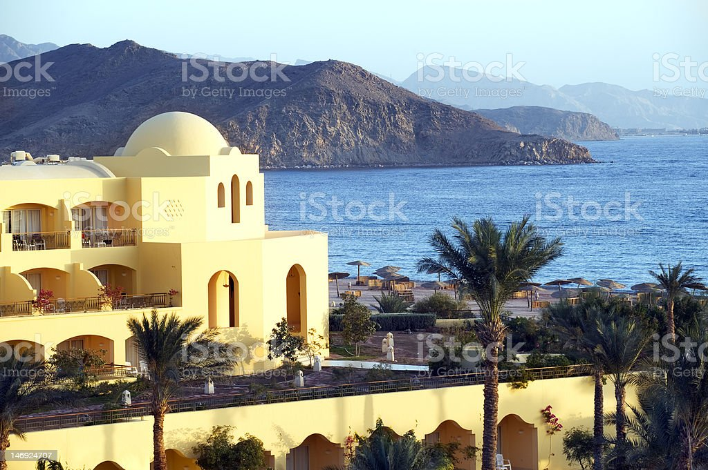 Beautiful Luxury Tourist Resort Hotel on the seashore stock photo