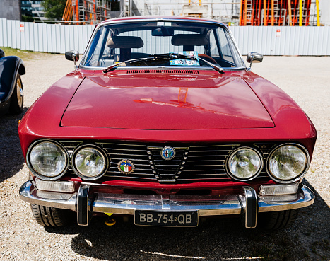 Strasbourg: Beautiful Red vintage luxury Alfa Romeo 2000 sport car parked on the street in France on a sunny day