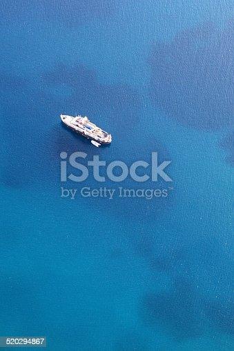 642777700 istock photo Beautiful luxury yacht anchored on the blue sea 520294867