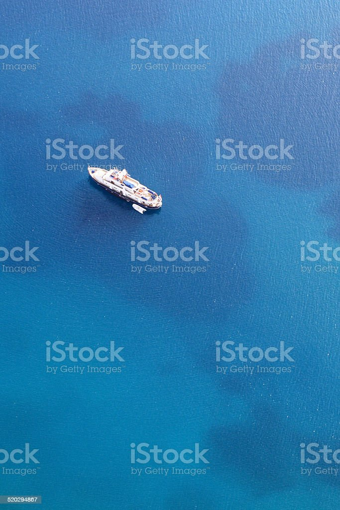Beautiful luxury yacht anchored on the blue sea stock photo