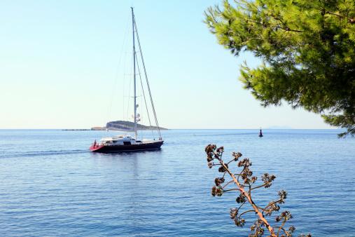 Beautiful luxury yacht sails from Cavtat harbor, Croatia