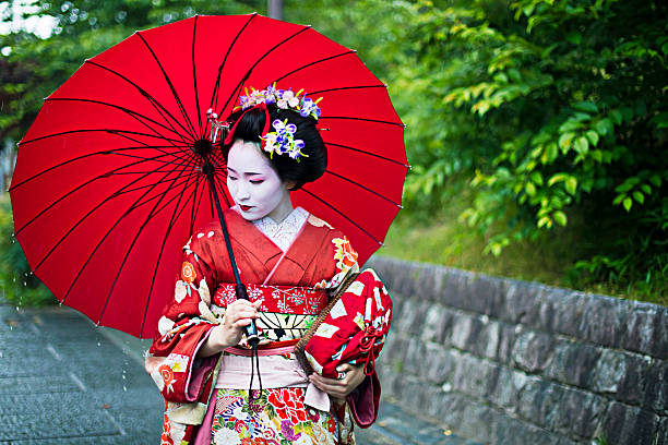 beautiful maiko in the streets of kyoto - geisha girl stock photos and pictures