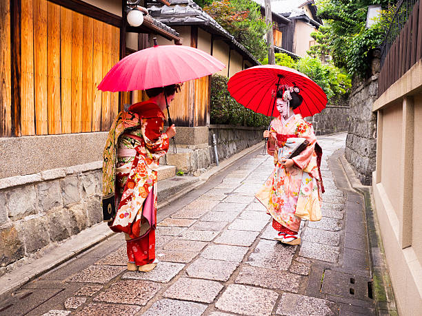 beautiful maiko ladies in kyoto. - geisha girl stock photos and pictures