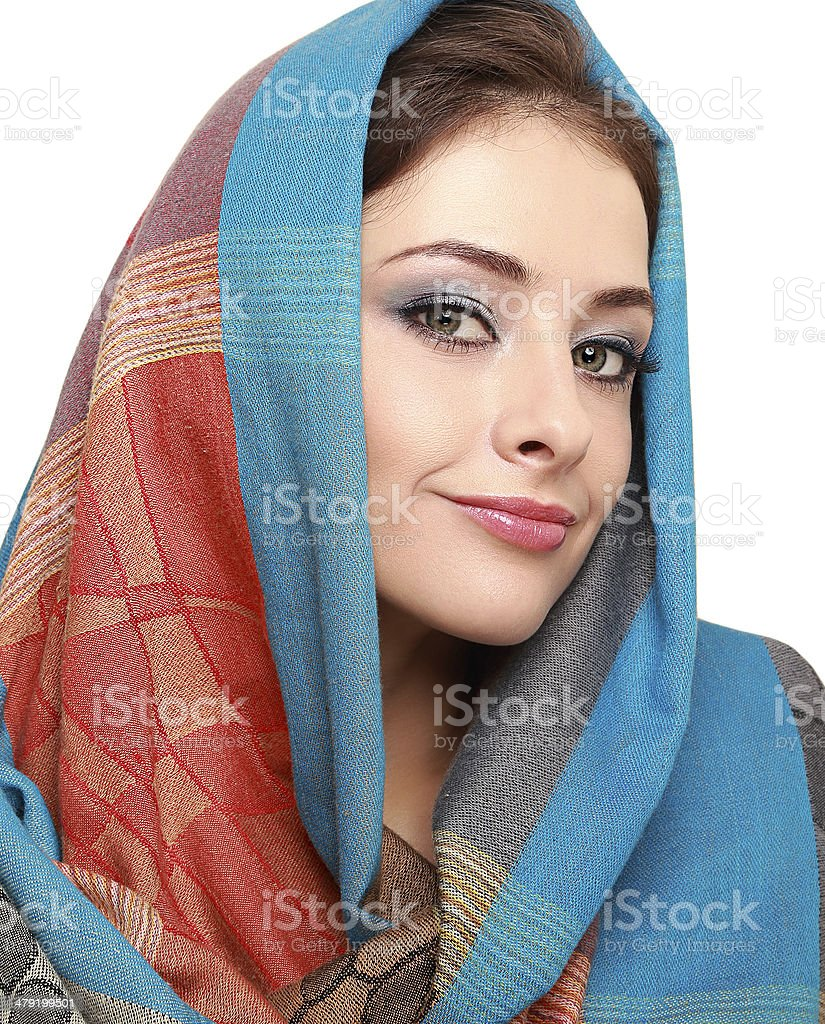 Beautiful makep woman in colorful shawl isolated on white. Closeup stock photo