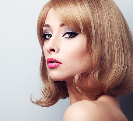 beautiful makeup blond woman with bright green eyes