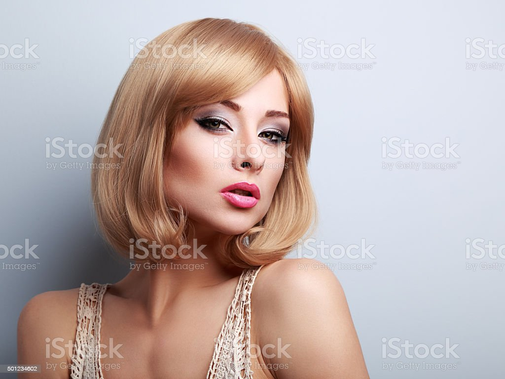 Beautiful Makeup Blonde Woman With Short Hair Style Looking Sexy