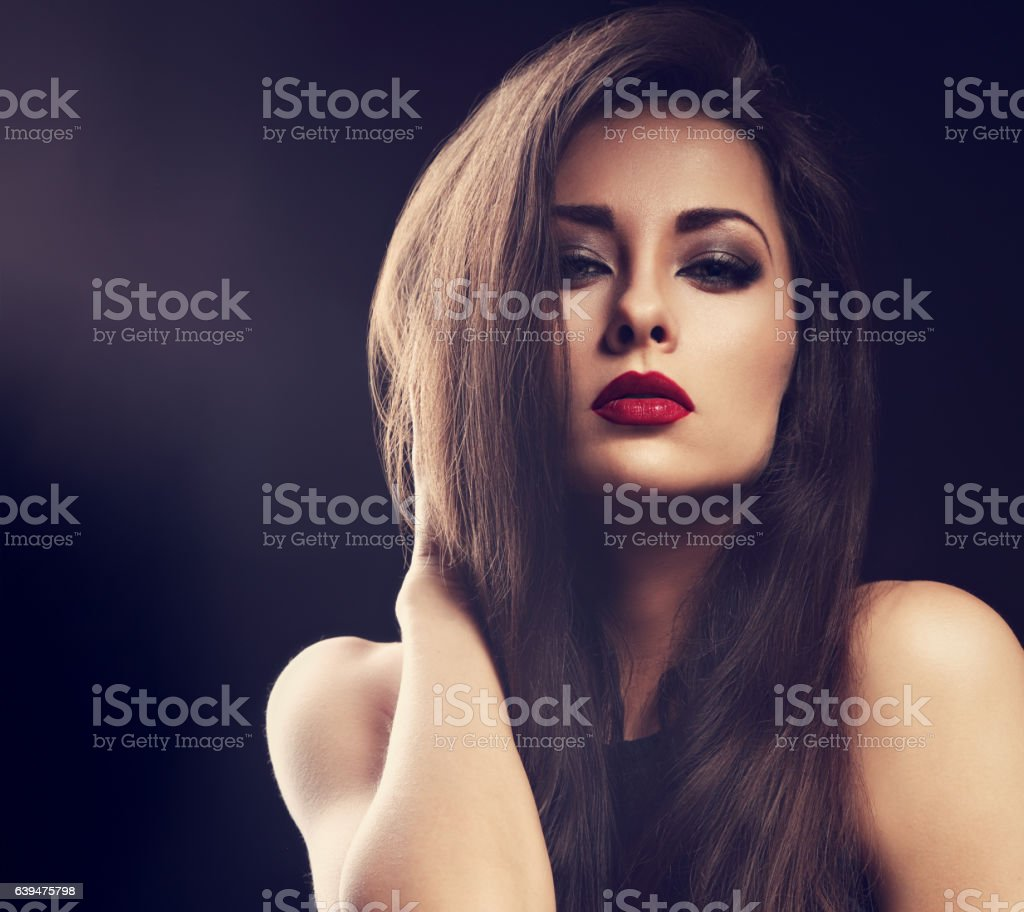 Beautiful makeup glamour female model with red lipstick and long stock photo