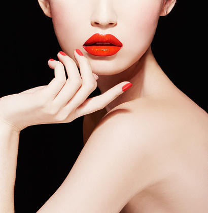 Beautiful makeup. red lips, nail polish manicure.isolated on black. stock photo