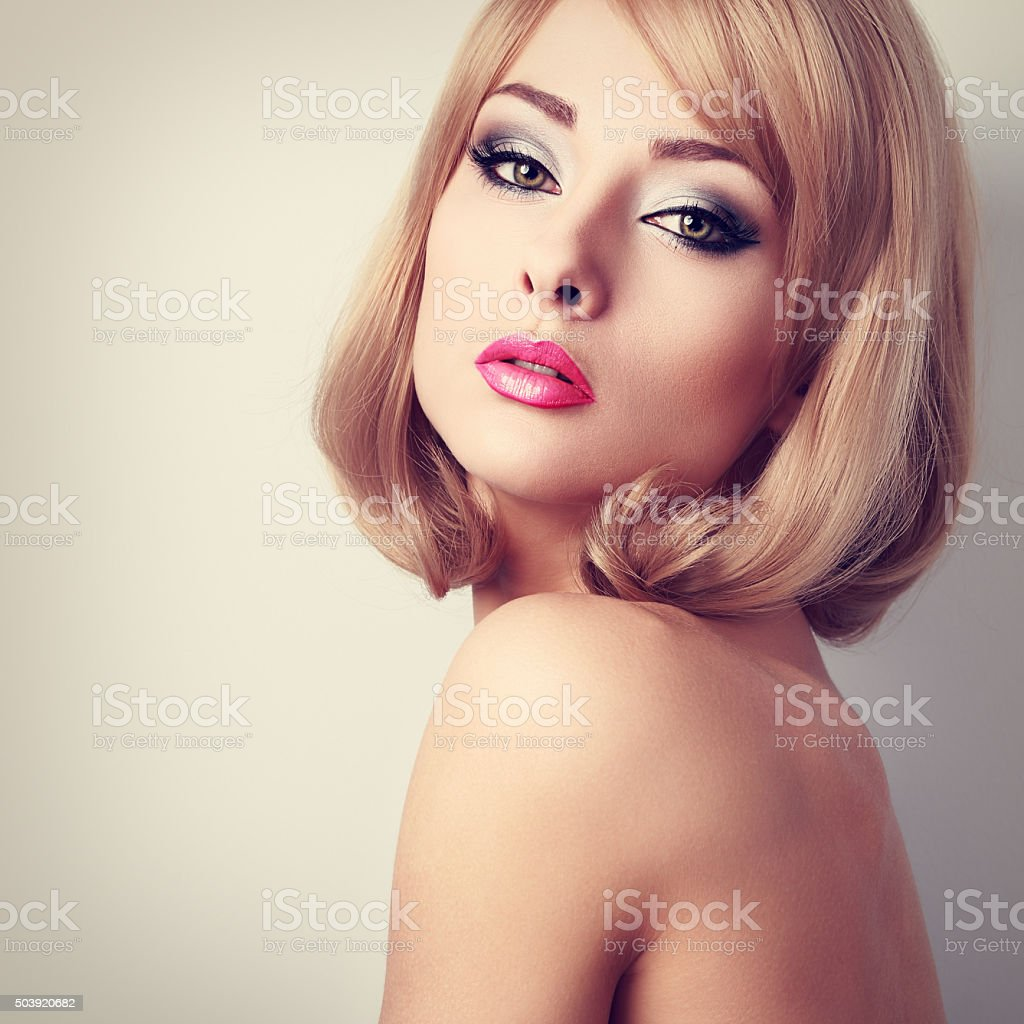 Beautiful Makeup Woman With Green Eyes And Pink Lipstick