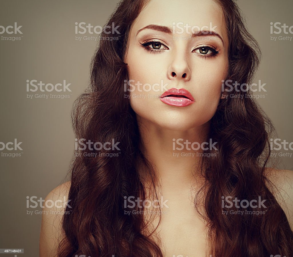Beautiful makeup woman with long curly hair stock photo