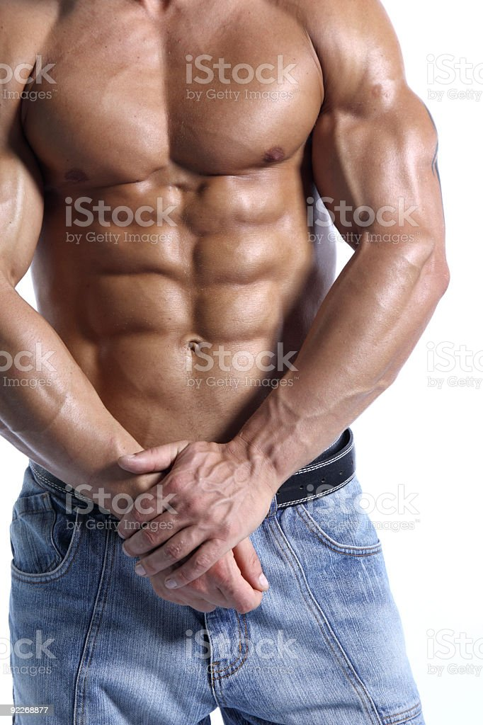 Beautiful male body in blue jeans royalty-free stock photo