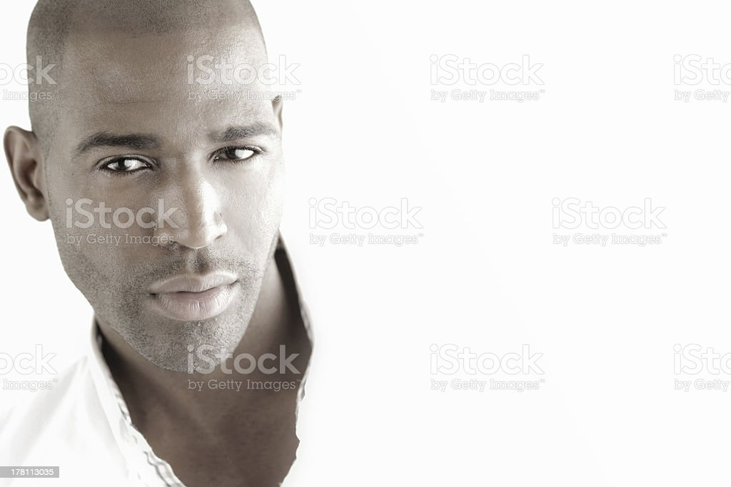 Beautiful male face in light stock photo
