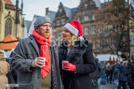 Beautiful Blonde Woman and handsome redhead man middle Aged Tourists in Germany at Christmas time