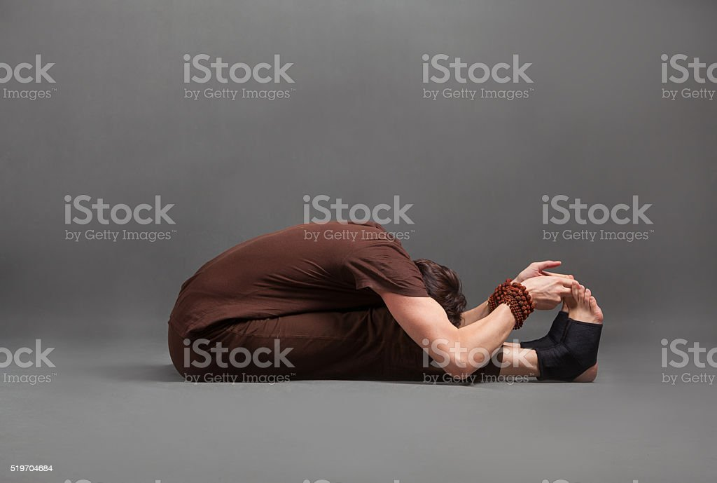 beautiful man doing yoga stock photo