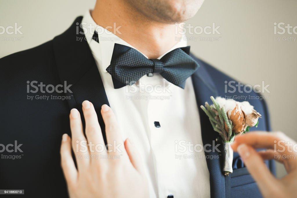 Beautiful man, groom posing and preparing for wedding stock photo