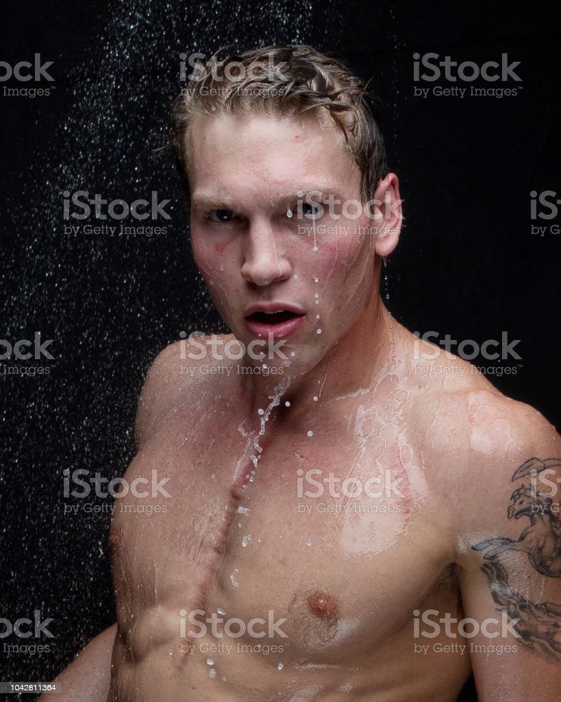 Beautiful man taking a shower - headshot stock photo