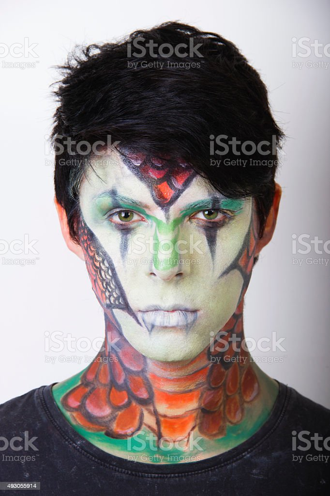 Beautiful man with abstract make up stock photo