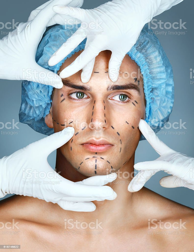 Beautiful Man with many surgical hands. stock photo