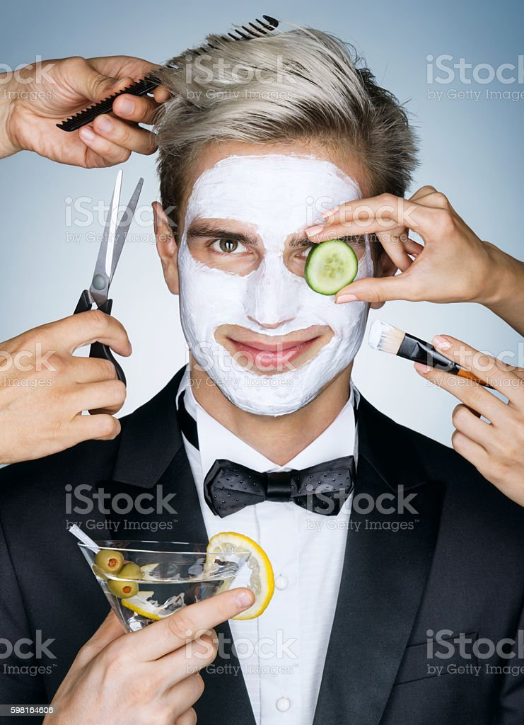 Beautiful man with moisturizing facial mask stock photo