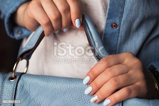 istock Beautiful manicure. Gel polish coating in blue, embossing. 682864924